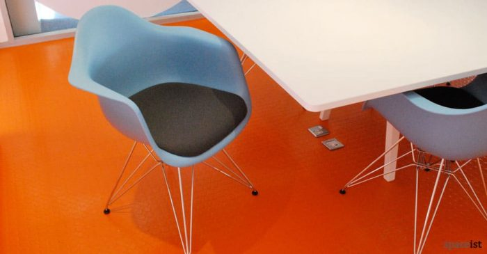 plastic blue tub meeting room chairs with a chrome base