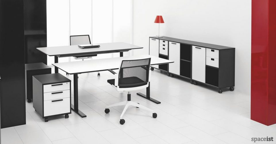 Q-10 standing office desk with a black leg and white top