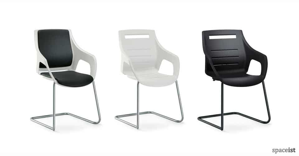 sputnik cantilever white chairs