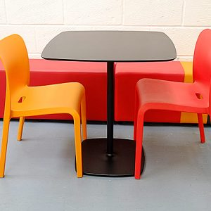 stylus black cafe table with orange pop chairs