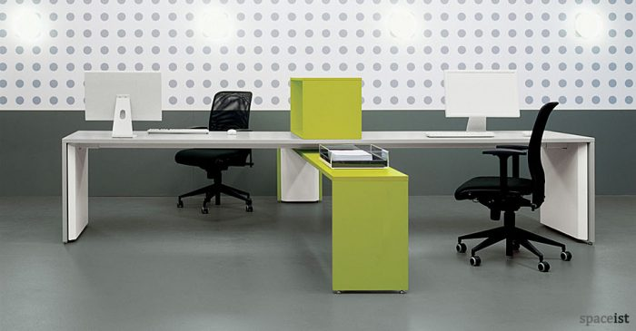 X shaped desk which seats two people