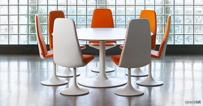 trumpet shaped large white meeting table