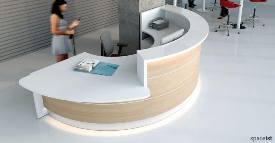 White and oak half circle reception desk