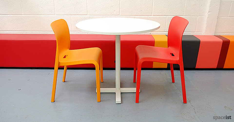 bold white round modern cafe tables