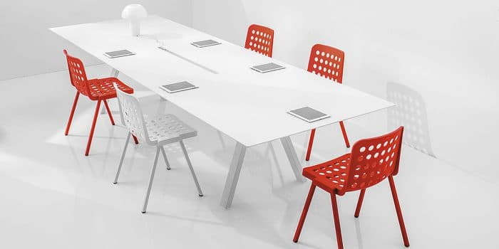 white conference table with red chairs